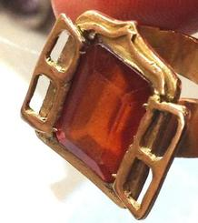 Window gold ring with a gemstone